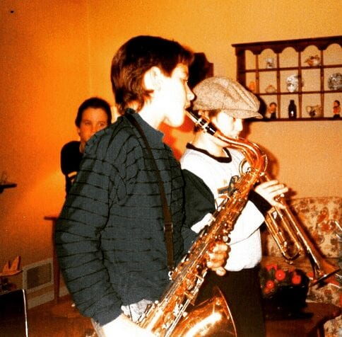 Jamming on the sax as a boy.