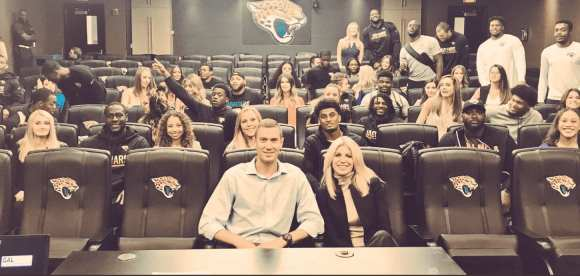 Laura (front right) alongside Tad Dickman of the Jaguars during a session with 23 Jacksonville rookies and 29 GALvanize enlistees