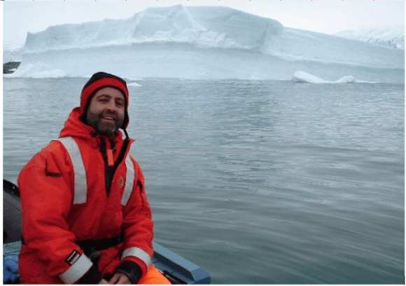 Ray in front of an iceberg in coastal waters of the Antarctic Peninsula.