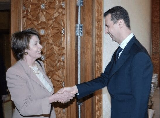 Pelosi and Assad, 2007. Glad to meet you. Let's have some pizza!
